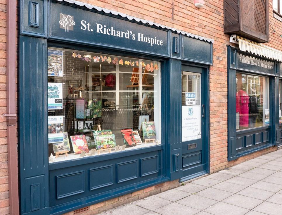 Vandals smash hospice shop window