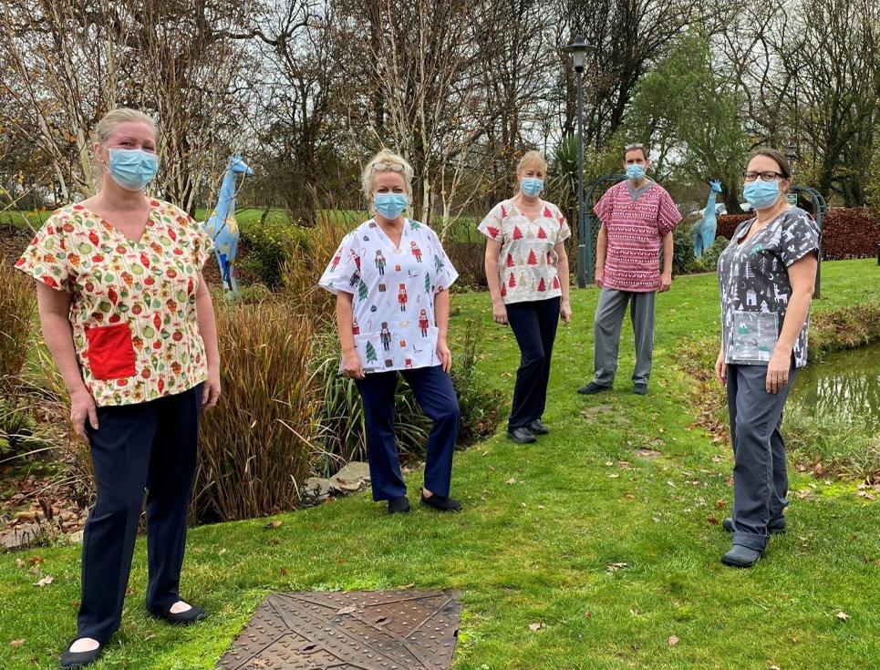 Volunteers donate festive scrubs to city hospice