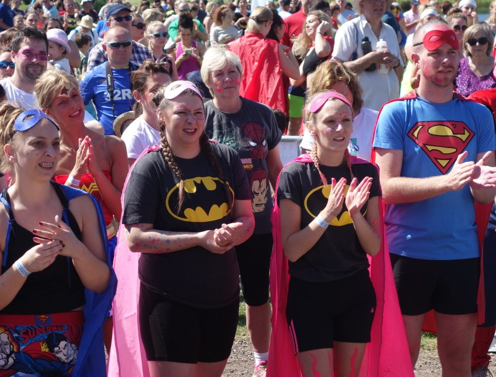 warm-up pre event in superhero costumes