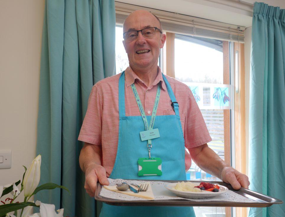 Colin Rowley serving food
