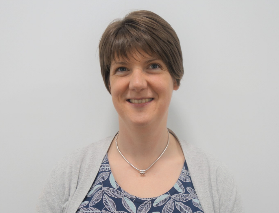 This button takes you to a page for Katherine Downey, Education and Learning Facilitator. Katherine is pictured smiling with short, brown hair and a light grey top.