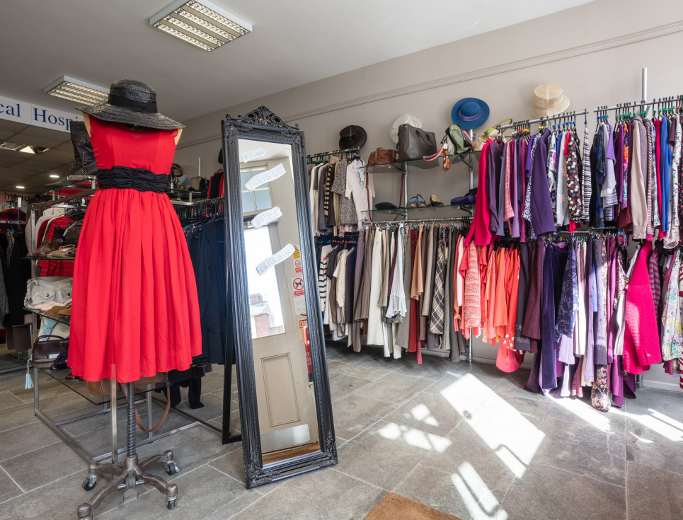 This button takes you to a page about our quality donation campaign. The image shows a shop mannequin wearing a red dress.