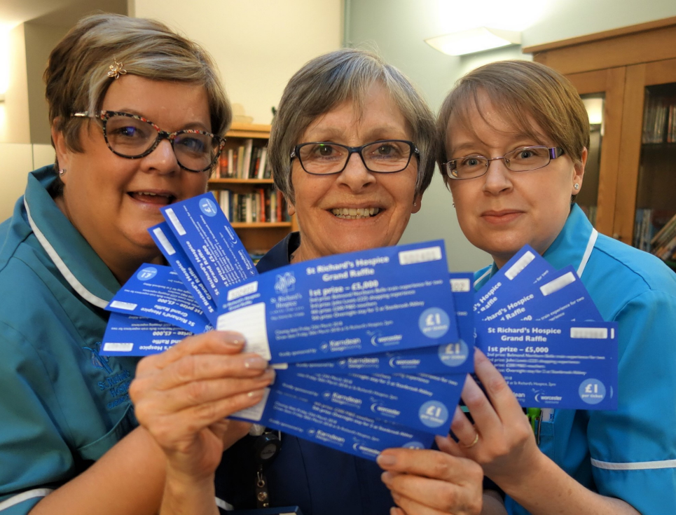 This button takes you to a page on raffles and lotteries. The button image is of three people in nurses' uniforms holding blue raffle tickets.